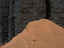 Bricks and sand. Piles of bricks and sand on a building site Royalty Free Stock Photo