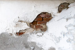 Bricks showing under the damaged wall surface Royalty Free Stock Photography