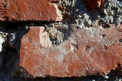 Bricks surrounded by mortar. Close up of a brick in a wall Stock Image