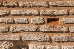 Bricks texture. Wall made of bricks, enlightened by the sunlight. Some bricks missing Royalty Free Stock Photography