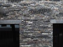Brick wall. Bricks and tiles as a wall material, grey stock photos