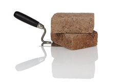 Bricks on trowel Royalty Free Stock Photos