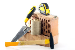 Bricks, trowel and hammer Royalty Free Stock Images