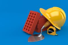 Bricks with trowel and hardhat. Isolated on blue background Stock Photo
