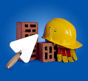 Bricks, trowel and helmet Royalty Free Stock Photos