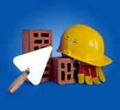 Bricks, trowel and helmet Royalty Free Stock Photos