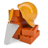 Bricks, trowel and a helmet Royalty Free Stock Image
