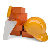Bricks, trowel and a helmet Stock Images
