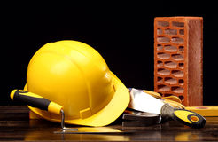 Bricks, trowel and helmet Stock Photography