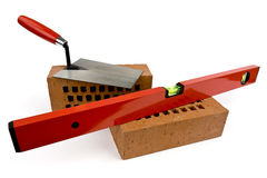 Bricks with trowel and spirit level Royalty Free Stock Photography
