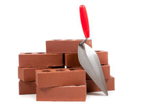 Bricks and a trowel on white Stock Photography