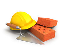 Bricks, trowel and a yellow plastic helmet Stock Photos