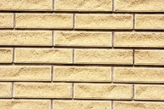 Bricks in the wall. Fragment of the wall, composed of light uneven bricks stock photography