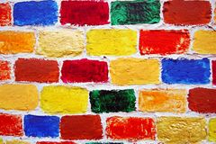 Bricks wall of many colorful painted bricks. Stock Photo