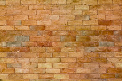 Bricks wall. In orange with slightly different tones royalty free stock photography