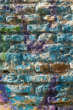 Bricks wall painted in different paint pastel colours. Royalty Free Stock Photos