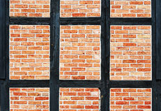 Bricks wall with timber Stock Images