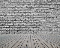 Bricks wall with wooden floor Royalty Free Stock Images