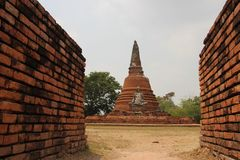 Bricks Walls And Traditional Style One Big Buddha With Old Stupa. Ancient Remains Old Buddhism Temple And  Buddha Staue Buddhist Relic Shrine. Ayutthaya stock photography
