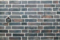Brickwall avec l'anneau en métal Images libres de droits