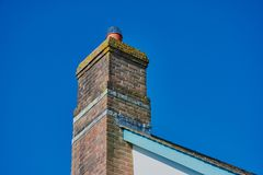 Brickwall chimney on the rooftop in North Cornwall royalty free stock image