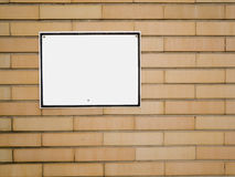 Brickwall with empty white sign Royalty Free Stock Image