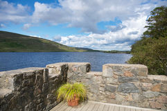 Brickwall at an irish lake. Brickwall on a sunny day in irland royalty free stock image