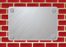 Brickwall metal plate Stock Image