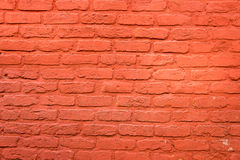 Brickwall with red plaster Stock Images