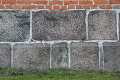 Brickwall with rock and grass background texture Royalty Free Stock Photos