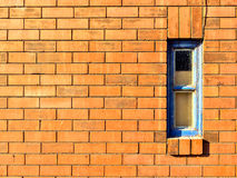 Brickwall with a small window Stock Images