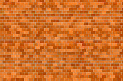 Brickwork. The new brickwork. Mosaic, straight rows, red-brown background Stock Photography