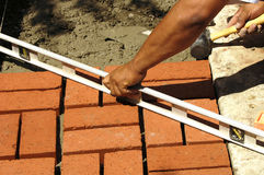 Brickwork. Leveling off brickwork Royalty Free Stock Image