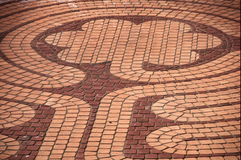 Brickwork. Floral patterned brick outdoor flooring Royalty Free Stock Photos