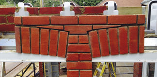 Brickwork arch. Construction of brickwork arches over windows royalty free stock images