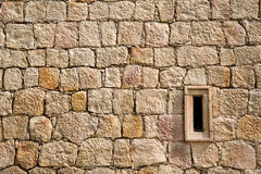 Brickwork with embrasure. Medieval brickwork with square embrasure Royalty Free Stock Images