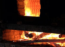 Brickwork, firewood, burning, exhaust fumes royalty free stock photo