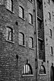 Brick Building. Frame filling shot of a renovated warehouse with windows and railings at Wells-Next-The-Sea stock photo