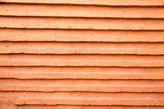 Brickwork of red brick with projecting horizontal rows. stock images
