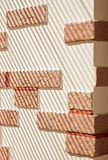 Brickwork Wall striped by sunlight. Brickwork Wall striped by jalousie sunlight stock images