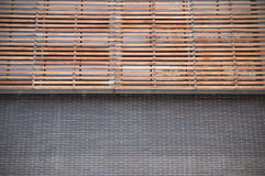 Brickwork and wooden facade. Symmetrical background. Stock Photos