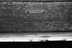 Brickwork Woolwich Dockyard Sign. Black and white bricks at Woolwich Dockyard train station in South East London Stock Photography