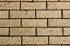 Brickwork. From yellow natural stone stock photo
