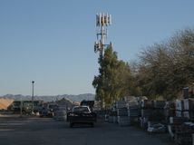 Brickyard Cell Tower. This cell tower is on the edge of a neighborhood just inside a brickyard. The mountains of Tucson AZ are in the background royalty free stock photos