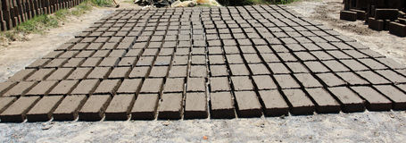 Brickyard. Doplang village is the center of the manufacture of bricks made of clay in a way how to make clay moistened with water and then mixed with rice bran Stock Images