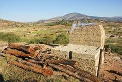 Brickyard nearby Antananarivo. Poor people make a bricks from the soil stock photography