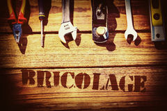 Bricolage against desk with tools Royalty Free Stock Images