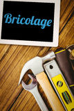 Bricolage against desk with tools Royalty Free Stock Photo
