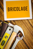 Bricolage against desk with tools Royalty Free Stock Photos