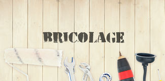 Bricolage against diy tools on wooden background Royalty Free Stock Photography
